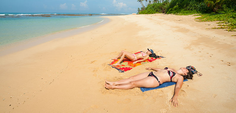 lebians-sunbathing-on-caribbean-beach